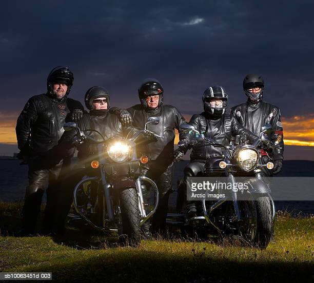 Group of friends with motorbike
