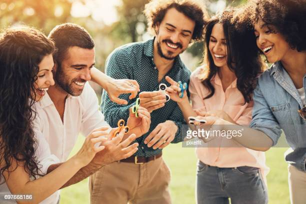 Group of friends with spinners