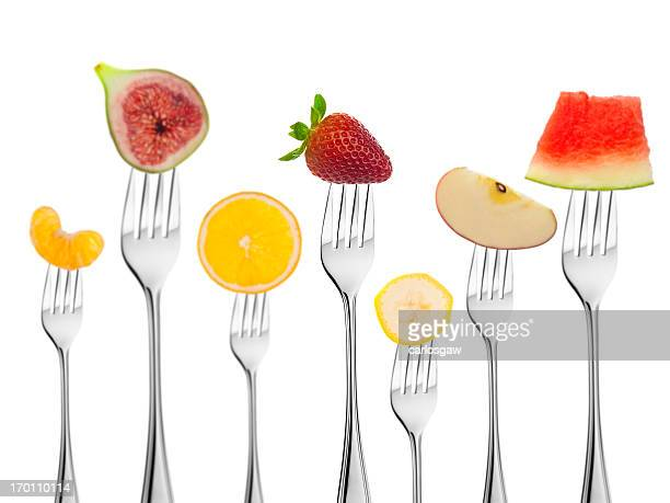 Group of Fruits on Fork