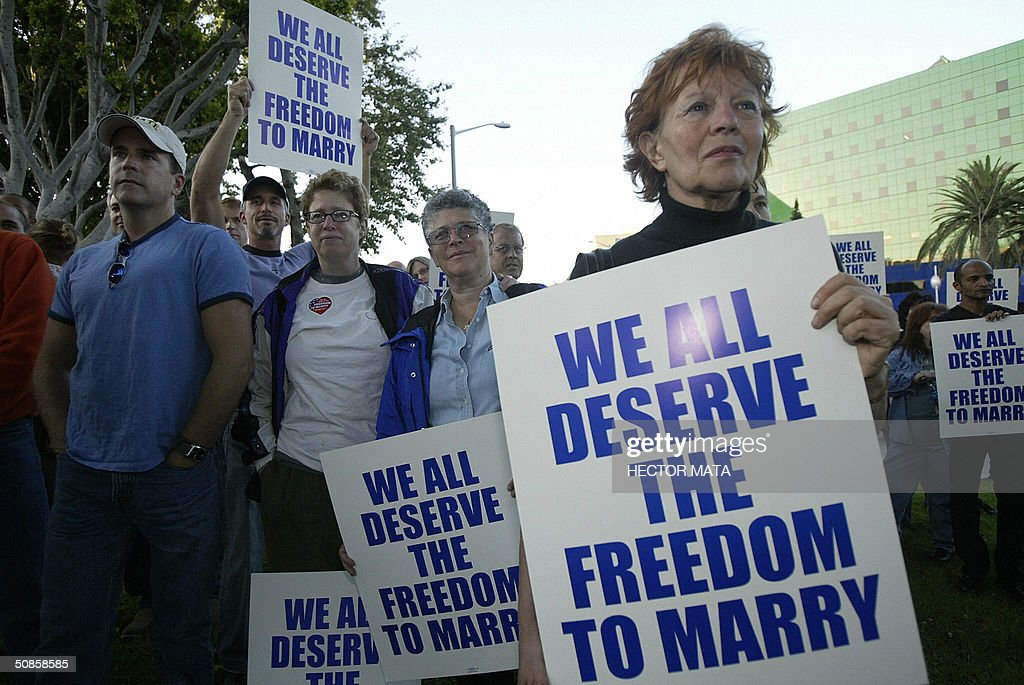 A group of gay, lesbians and community rights activists attend a rally celebrating marriage equality and recognizing the issuance of same sex marriage licenses in Massachusetts in West Hollywood, CA 19 May 2004. Massachusetts was the first state to issue such licences as the controversy continues among legislators and politicians.