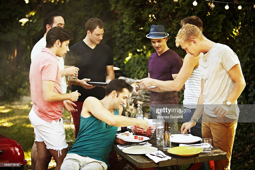 Group of gay men having a backyard barbecue : Stock Photo