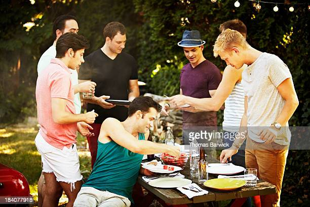 Group of gay men having a backyard barbecue