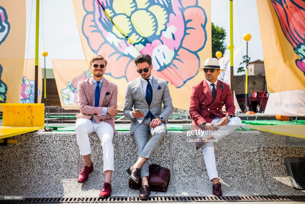 Group of gentleman are seen during Pitti Immagine Uomo 92. at Fortezza Da Basso on June 14, 2017 in Florence, Italy.