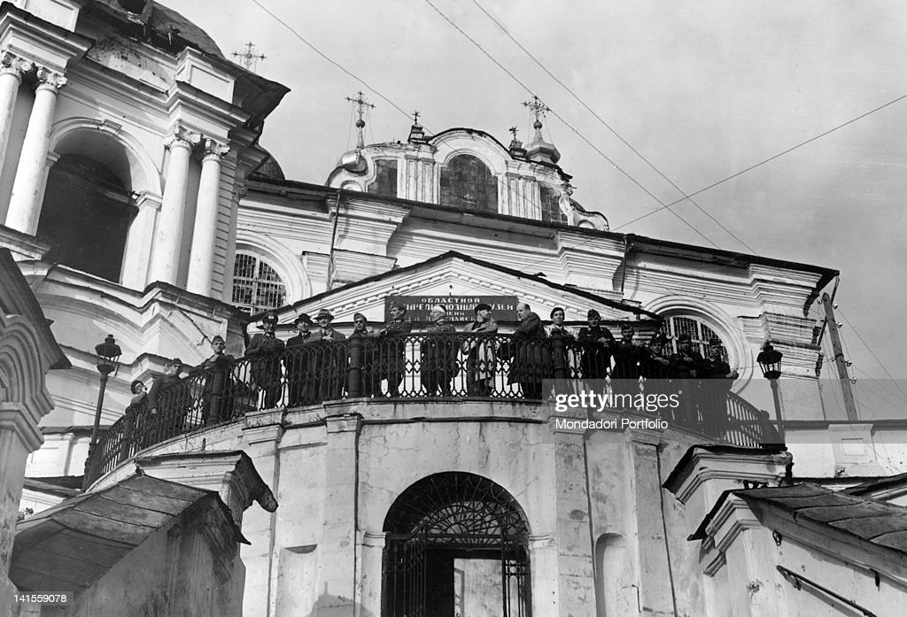 A group of German journalists accompanied by some army officers looking at the site of the battle from the top of the cathedral Smolensk July 1941