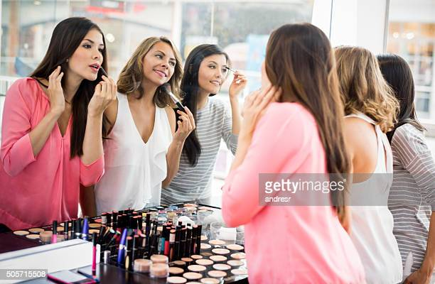 Group of girl friends applying makeup
