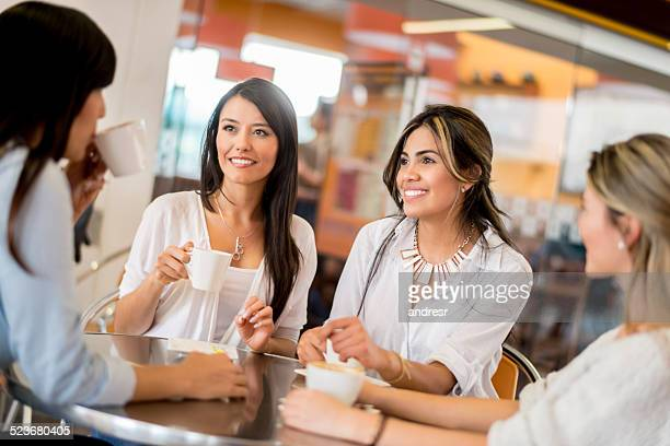 Group of girl friends having coffee