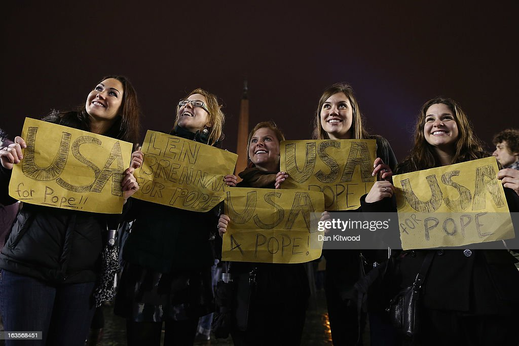A group of girls from Pennsylvania in the USA wave signs as they wait for an indication as to whether the College of Cardinals have elected a new Pope in St Peter's Square on March 12, 2013 in Vatican City, Vatican. Pope Benedict XVI's successor is being chosen by the College of Cardinals in Conclave in the Sistine Chapel. The 115 cardinal-electors, meeting in strict secrecy, will need to reach a two-thirds-plus-one vote majority to elect the 266th Pontiff.