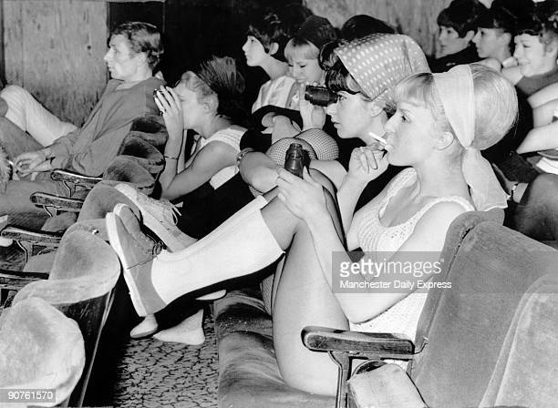 A group of girls in beehive hairdos attending a Tony Bennett concert