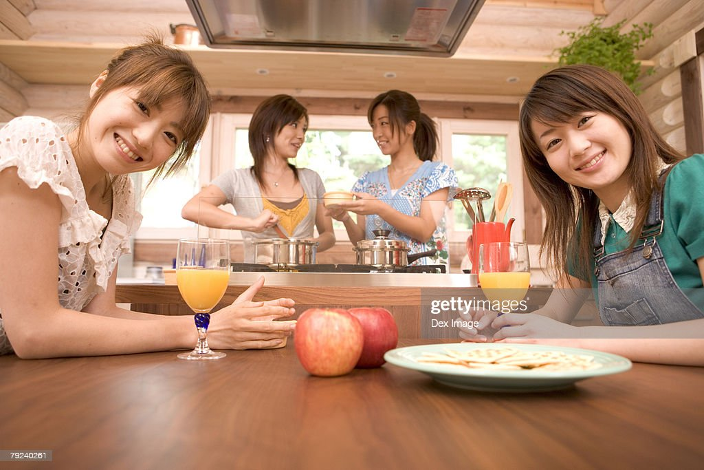 A group of girls in the kitchen : Stock Photo
