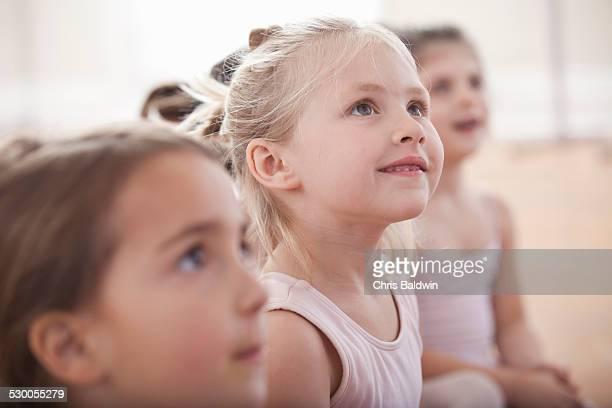 Group of girls looking up in ballet school