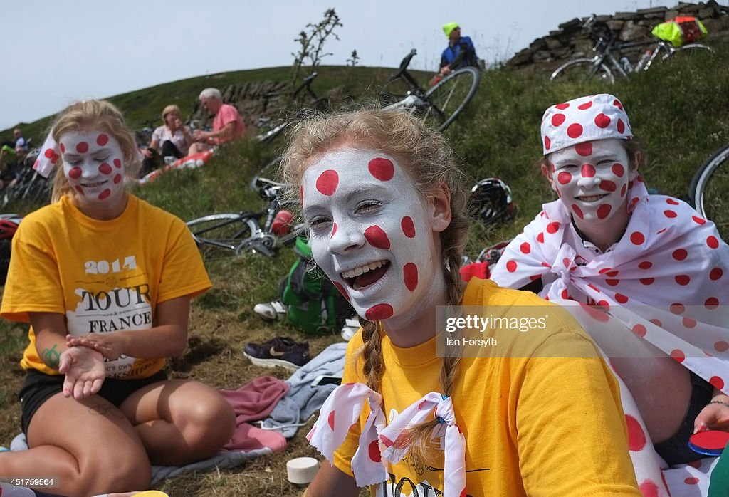 A group of girls paint their faces in King of the Mountain colours as they get ready to watch Stage 2 of the Tour de France on July 6, 2014 in Holm Moss, United Kingdom. The world's greatest cycle race, the Tour de France started for the first time in its history in Yorkshire this weekend. The event has brought thousands of cycling fans to Yorkshire.