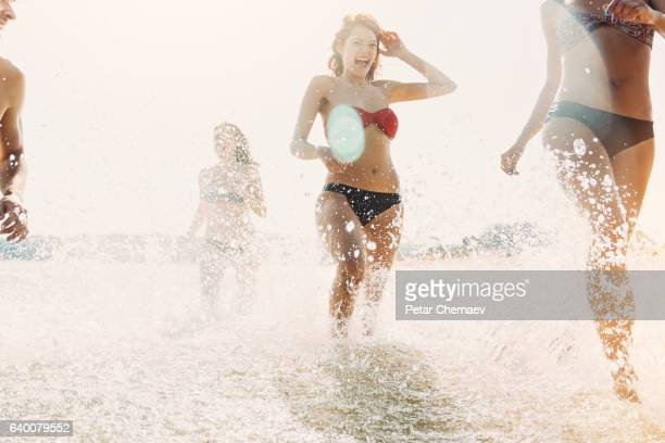 Group of girls splashing in the sea