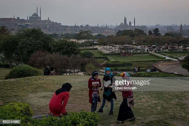 A group of girls talk in a park overlooking the Cairo skyline on December 10 2016 in Cairo Egypt Since the 2011 Arab Spring Egyptians have been...