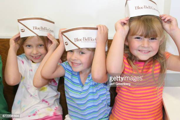 A group of girls wearing Blue Bell Creameries hats