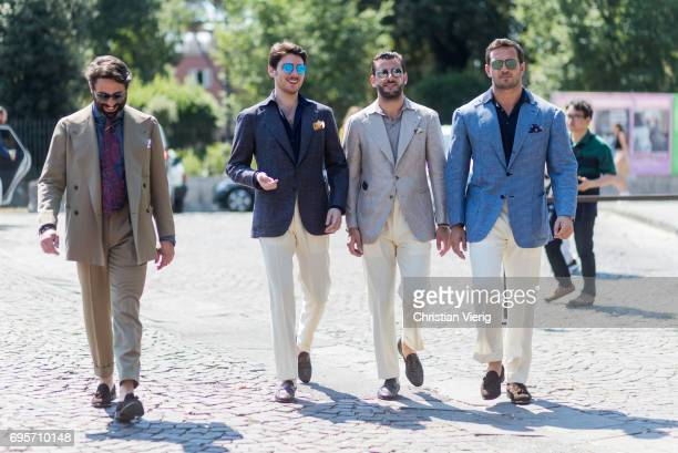 A group of guests wearing suits is seen during Pitti Immagine Uomo 92 at Fortezza Da Basso on June 13 2017 in Florence Italy