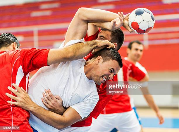 Group of handball players in action.