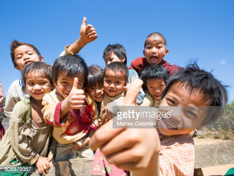 Group of happy asian children with thumbs up