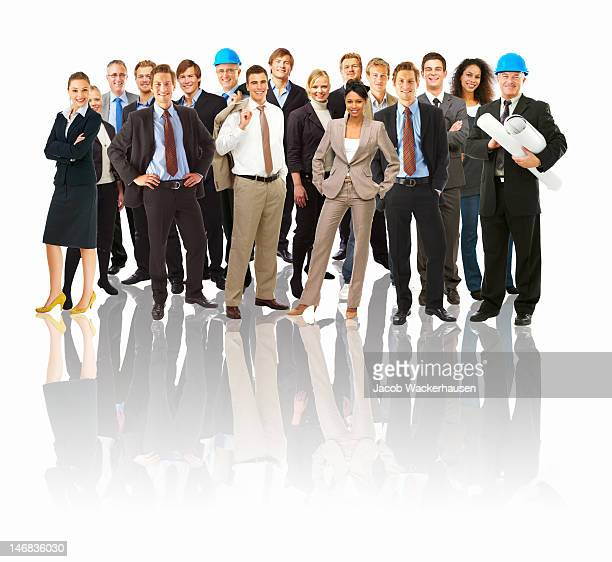Group of happy business people standing together against white background