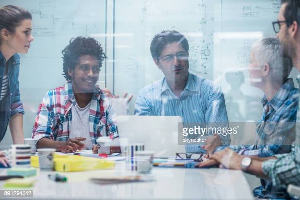 Group of happy business people talking on a meeting.