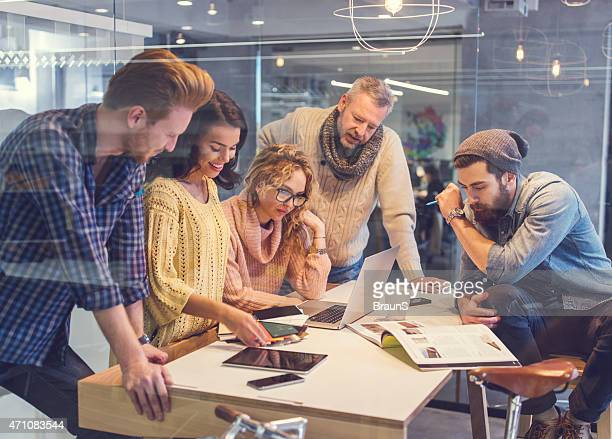 Group of happy creative people working together in the office.