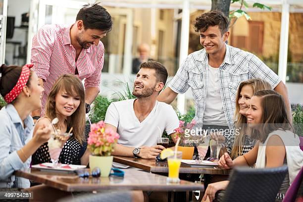 Group Of Happy Friends In Sidewalk Cafe