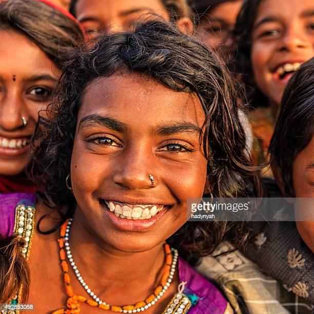 Group of happy Gypsy Indian children, desert village, India
