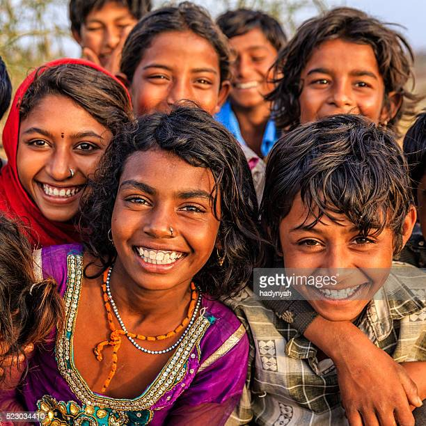Group of happy Gypsy Indian children, desert village, India