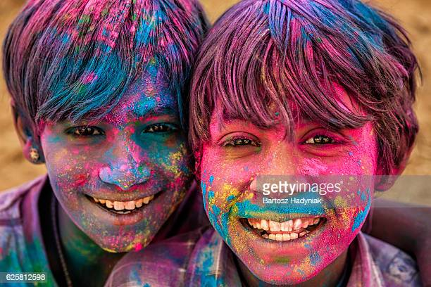 Group of happy Indian boys playing holi, desert village, India
