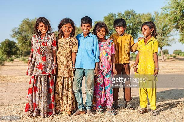 Group of happy Indian children in desert village
