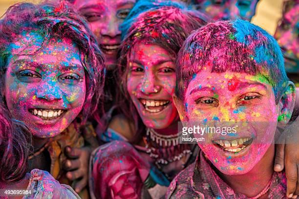 Group of happy Indian children playing holi, desert village, India