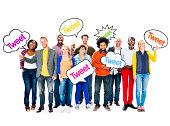 Group Of Happy Multi-Ethnic People Holding Speech Bubbles With The Word Tweet