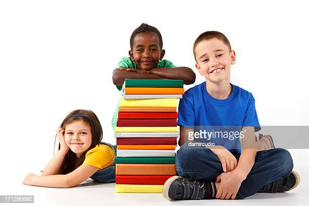 Group of happy multiracial school children with books