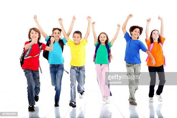 Group of happy running children.
