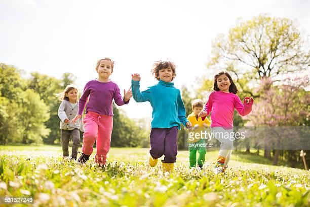 Group of happy running kids.