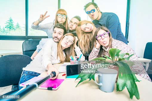 Group of happy students employee workers taking selfie at work : Foto de stock