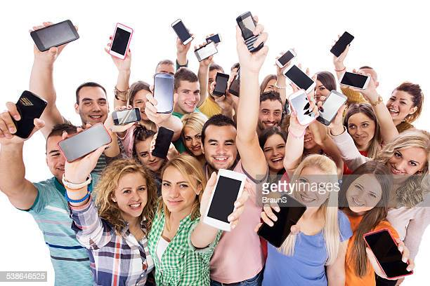 Group of happy young people with cell phones.