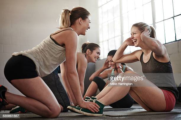 Group of healthy women doing sit-ups together