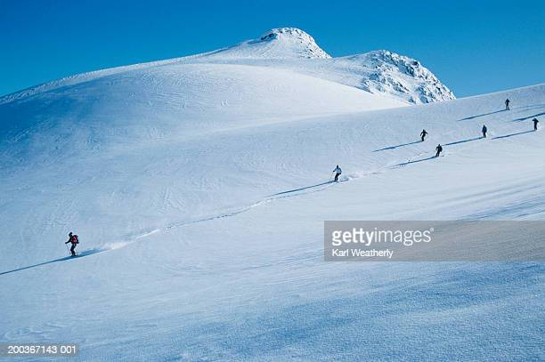 Group of heli-skiers going downhill near Whistler, British Columbia