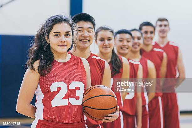 Group of high school basketball players posing for camera