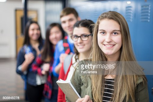 Group of high school students posing together