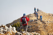 Pescasseroli (AQ), Italy - August 31, 2017: Group of hikers reach the top of the ridges of the mountains of Pescasseroli, near the Iorio Refuge.