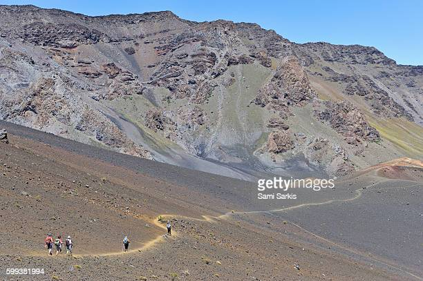 Group of hikers walking in the Haleakala crater, Haleakala National Park, Maui Island, Hawaii Islands, USA