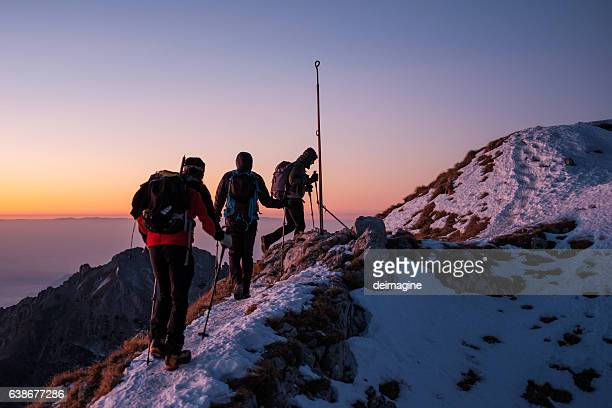 Group of hikers walking on top of the mountain range