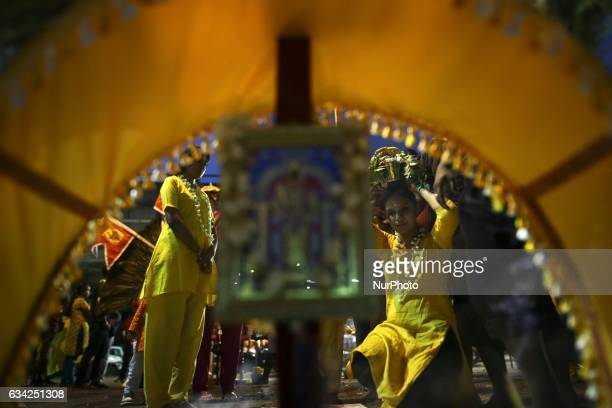 A group of Hindu devotee make their way towards the Batu Caves to perform religious rites for the Thaipusam festival at Batu Caves in Kuala Lumpur...