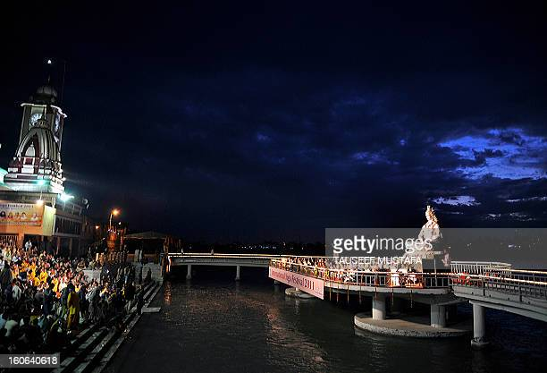 A group of Hindu devotees and international participants of yoga perform a puja ceremony the worship of Lord Shiva during the Hindu festival Maha...