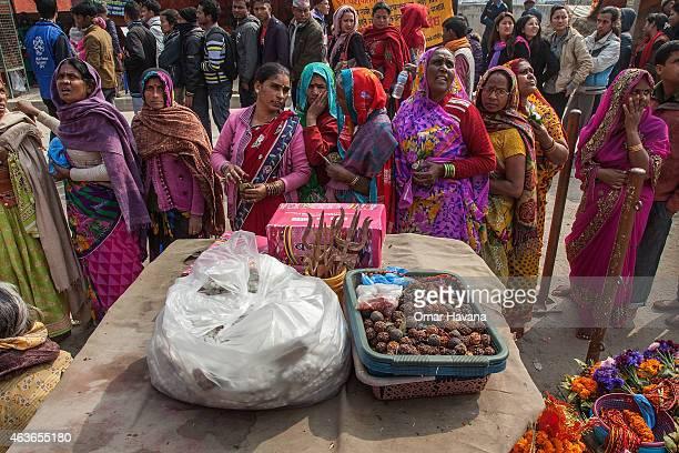 A group of Hindu devotees queue to enter Pashupatinath temple for the celebration of the Maha Shivaratri festival on February 17 2015 in Kathmandu...