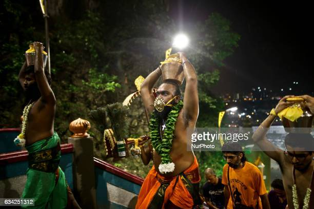 A group of Hindu devotees tongue is pierced making their way towards the batu cave to perform religious rites for the Thaipusam festival at Batu...