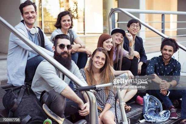 Group of hip friends sitting on stairs, portrait