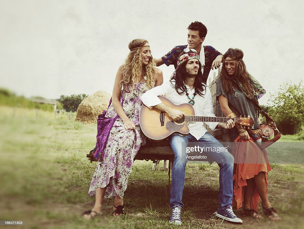 Group of Hippie Singing in Countryside : Stock Photo