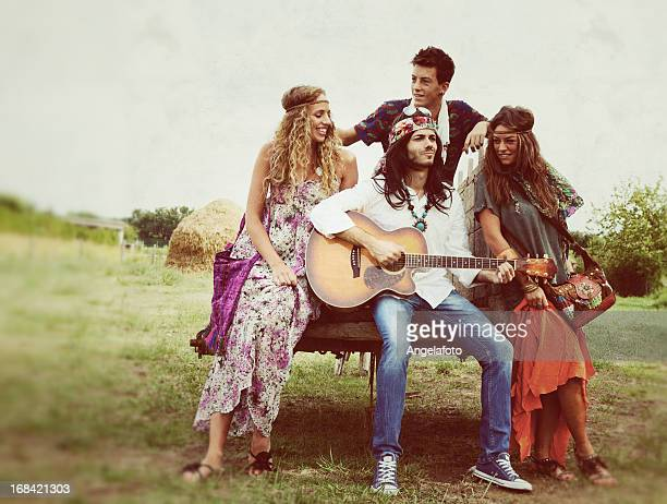 Group of Hippie Singing in Countryside
